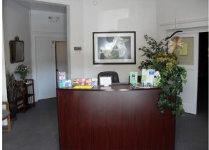 A photo of the front desk of the Holistic Xchange, a Wellness Center in California